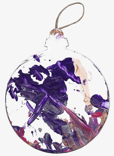 An abstract acrylic painting on a wooden ornament with burgundy, silver, gold, and purple streaks and dots